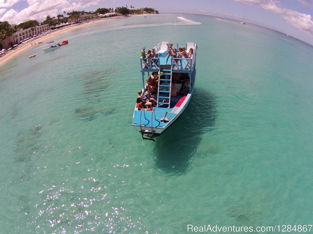 We offer traditional glass bottom boat cruises along the scenic west coast of Barbados. First snorkel with the turtles and then the shipwreck and beautiful coral reef with all its tropical fish.We offer full watersports Jetskis and great Taxi Service