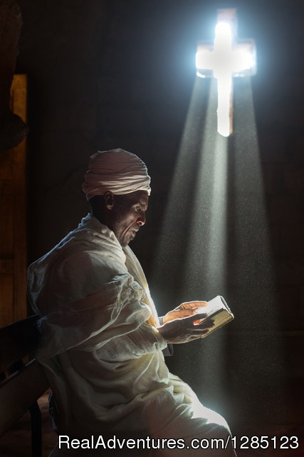 Image of a priest on prayer - Luxury Ethiopia Tours with His-Cul Tour Operator