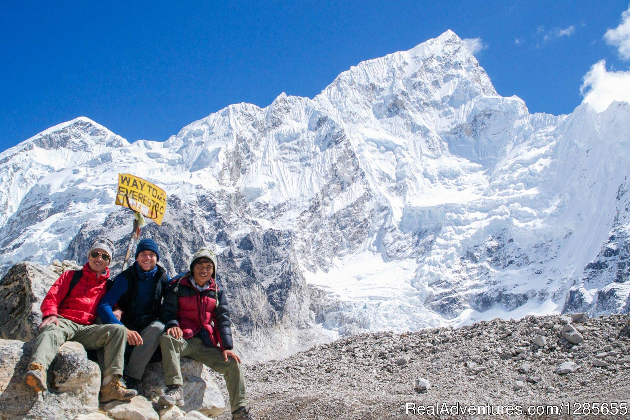 Our Guide Laximan & Chris are standing at Everest Base Camp
