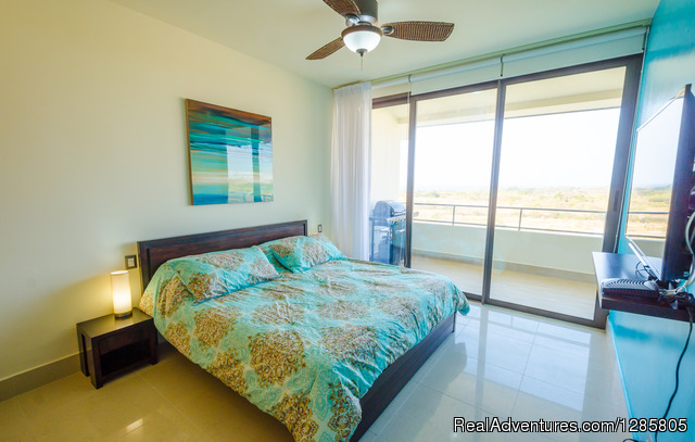 Master Bedroom - To Golf? or to Surf? That is the Question.